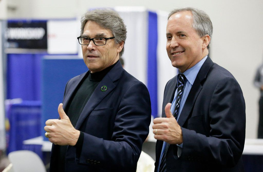 U.S. Secretary of Energy Rick Perry (left) had pushed Trump to renegotiate the Paris deal, rather than withdraw. Texas Attorney General Ken Paxton has been a major opponent of Obama-ear climate policies.