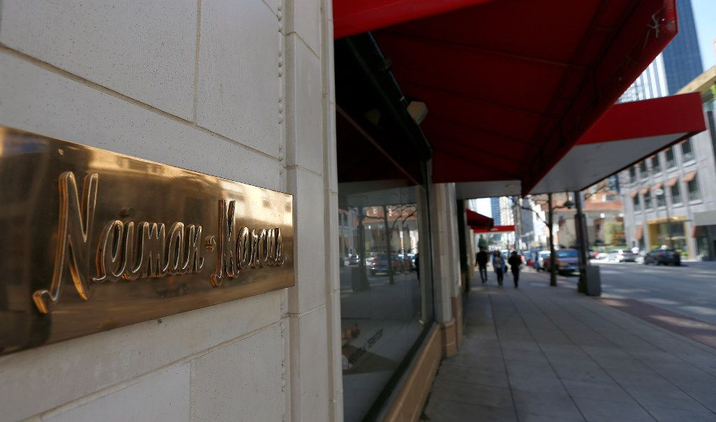 File photo: Pedestrians are reflected in a sign of Neiman Marcus on Main Street in downtown Dallas, Texas.