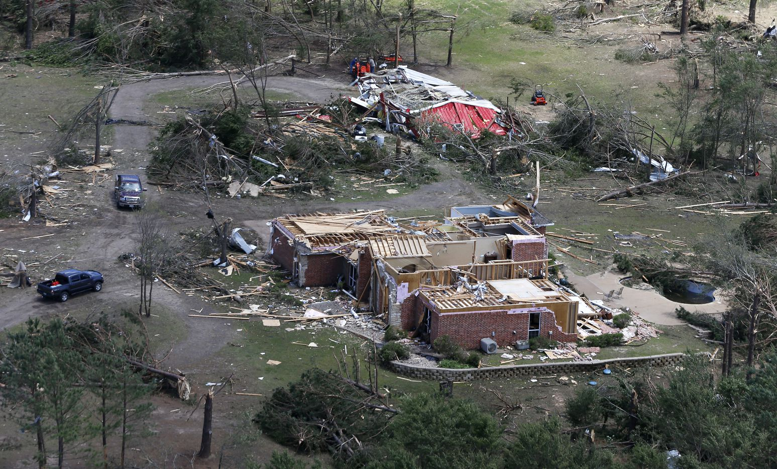 A house is damaged by yesterday's tornado in Canton, Texas, Sunday, April 30, 2017.