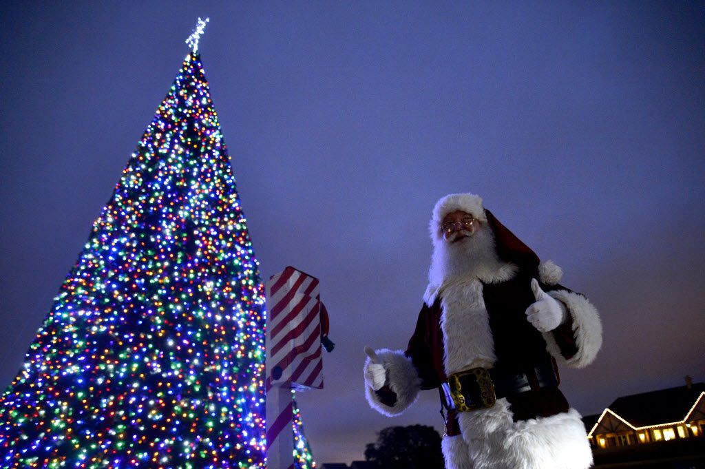 In this file photo, Ken McClure, dressed as Santa, gives a thumbs up after pulling a lever to light the Christmas tree during the Holiday in the Plaza and Tree Lighting event in Lewisville.