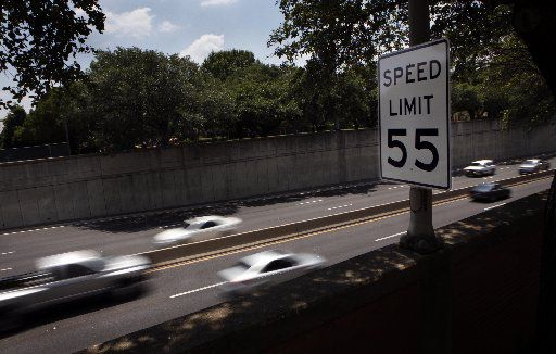 A speed limit sign says 55 mph on southbound Dallas North Tollway between Faifax Avenue and Edmondson Avenue in Highland Park.