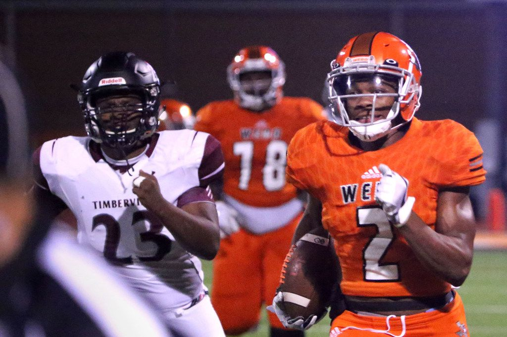 Timberview linebacker Ron Reed (23) chases Lancaster running back Tre Bradford (2) during their high school football game in Lancaster, Texas on Friday, October 26, 2018. The Lancaster Tigers were beating the Timberview Wolves 14 to 7 at the end of the first half. (Daniel Carde/The Dallas Morning News)