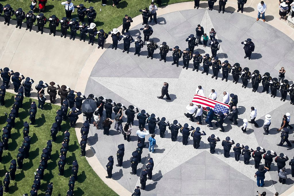 The casket of slain Dallas police officer Patrick Zamarripa is carried by an honor guard during a ceremony at Dallas Fort Worth National Cemetery on Saturday, July 16, 2016 in Dallas.  Zamarripa was one of five law enforcement officers killed last week in an ambush at a Black Lives Matter rally.  (Smiley N. Pool/The Dallas Morning News)