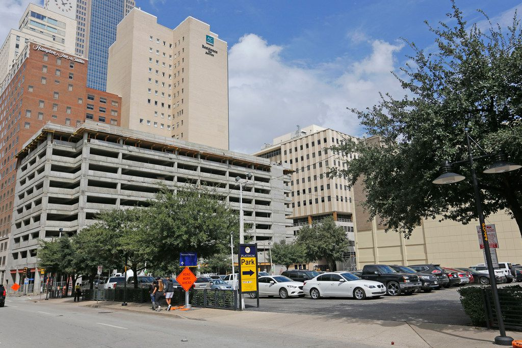A parking lot where Club Reno once was at 316 S. Ervay is full of vehicles in downtown Dallas Monday, October 8, 2018.