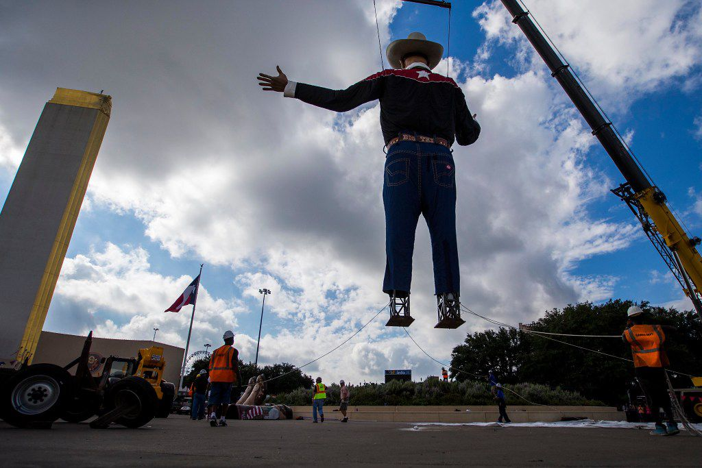 Big Tex is lifted by a cranes into his position as workers install the State Fair of Texas icon in Fair Park on Friday, Sept. 23, 2016, in Dallas. The State Fair of Texas opens on September 30 and runs through October 23. (Smiley N. Pool/The Dallas Morning News)