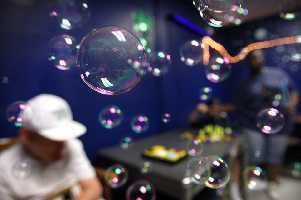 Intellectual and developmentally disabled residents receive sensory therapy through blowing bubbles at the Austin State Supported Living Center in Austin.