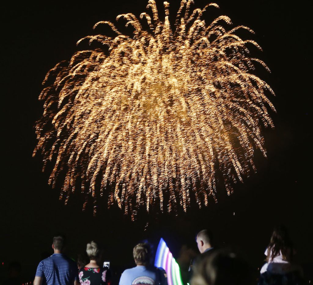 People watch the fireworks finale from the top deck of a parking garage at the Gaylord Texan Hotel in Grapevine.