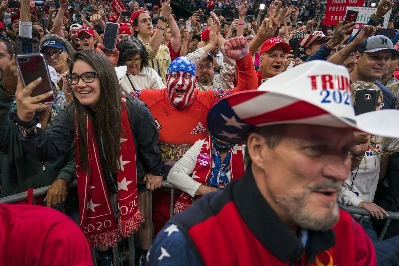 Supporters cheer as President Donald Trump takes the stage for a campaign rally at the American Airlines Center on Thursday, Oct. 17, 2019, in Dallas.