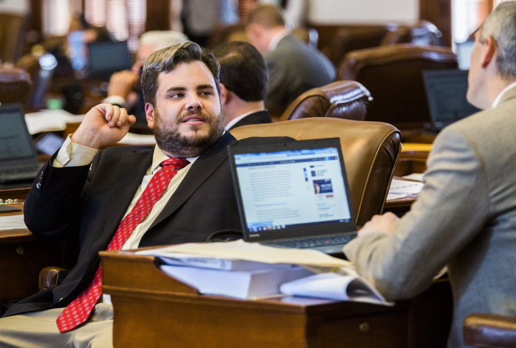 Rep. Jonathan Stickland, R-Bedford, left, talks to a colleague during the final days of the 84th Texas Legislature in May 2015 at the Texas Capitol in Austin, Texas. (Ashley Landis/The Dallas Morning News)