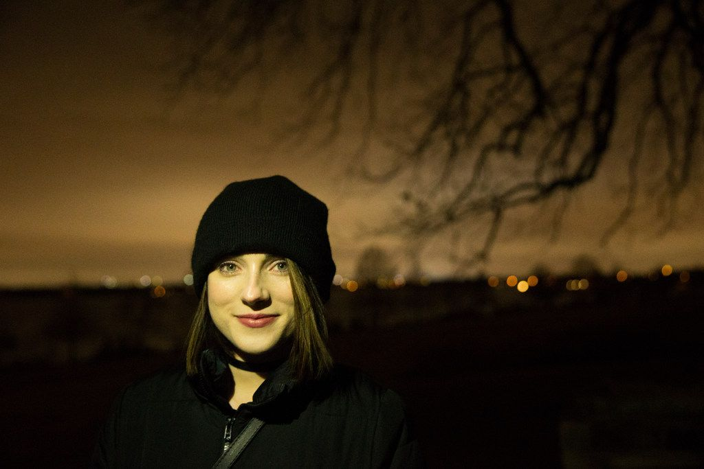 Fallon Stovall poses for a portrait at White Rock Lake with Haunted Rooms in Dallas on Friday, December 14, 2018. Stovall reached out to Curious Texas and asked if the lake is haunted. (Daniel Carde/The Dallas Morning News)