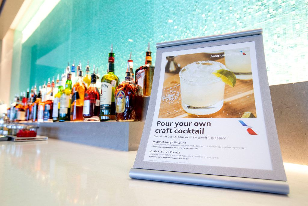 A pour-your-own cocktail station is displayed in the new American Airlines Flagship Lounge on Monday, May 13, 2019 in Terminal D at DFW Airport in Grapevine, Texas. (Jeffrey McWhorter/Special Contributor)