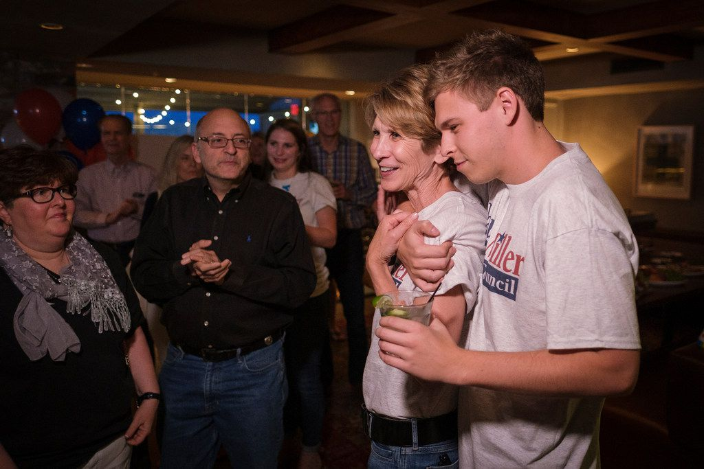 Former Mayor Laura Miller, who ran against incumbent Jennifer Staubach Gates for the Dallas City Council District 13 seat, gets a hug from her son Max as she addresses supporters during an election night watch party on Saturday, May 4, 2019.