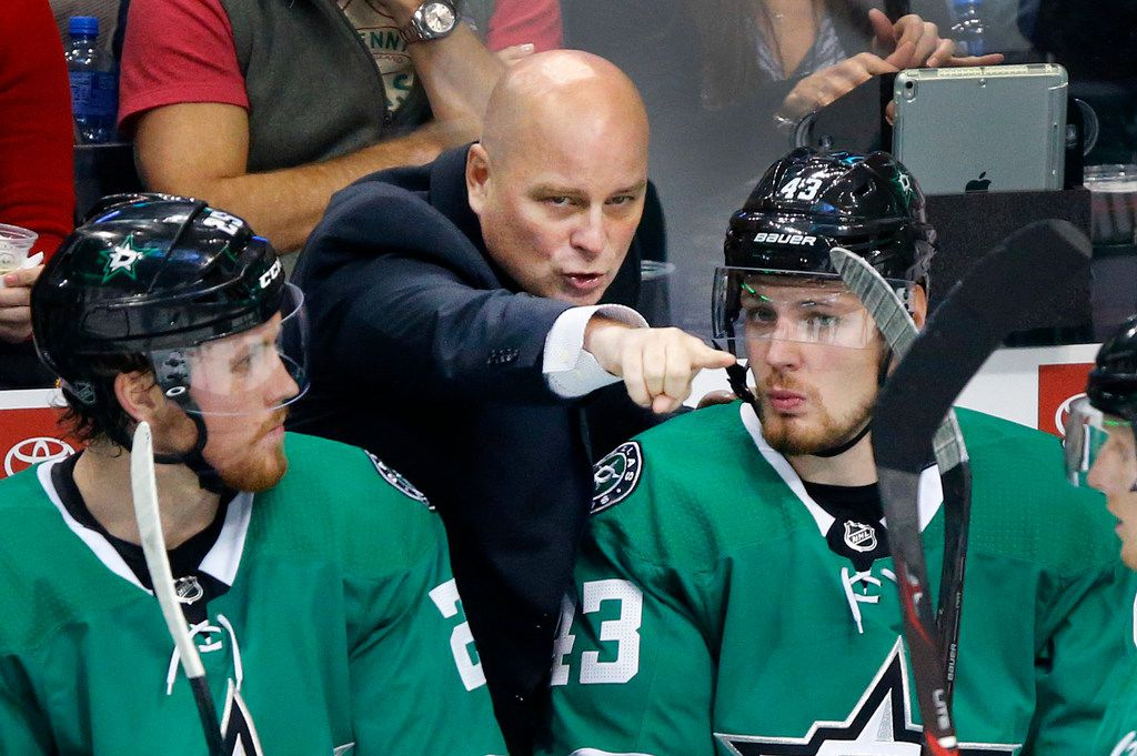 Dallas Stars head coach Jim Montgomery gives instruction to right wings Brett Ritchie (25) and Valeri Nichushkin (43) during the second period against the Toronto Maple Leafs at the American Airlines Center in Dallas, Tuesday, October 9, 2018. (Tom Fox/The Dallas Morning News)