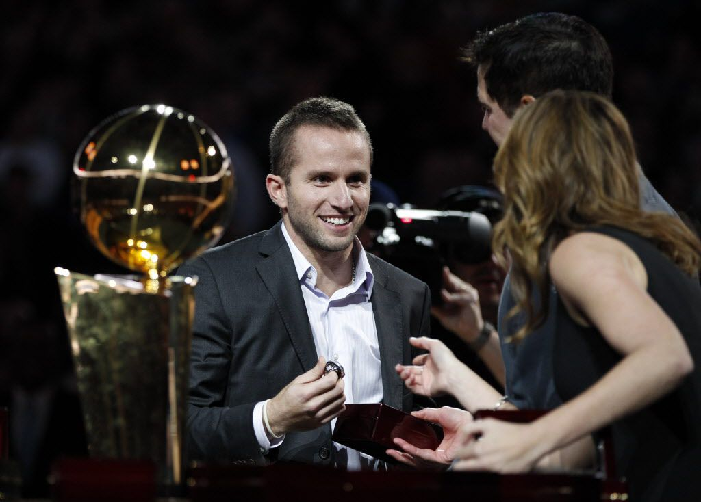Minnesota Timberwolves point guard Jose Juan Barea (11) talks with Sarah Melton as he receives his NBA championship ring during the ring ceremony at the American Airlines Center in Dallas on January 25, 2012. (Vernon Bryant/The Dallas Morning News)