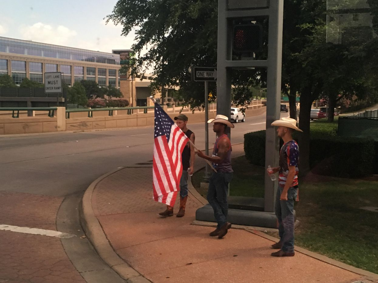 Counter protesters stand near U.S. Highway 75 and Park Lane.