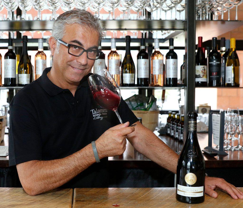 Daniele Puleo, chef-owner of CiboDivino Marketplace in Dallas, swirls a glass of Lambrusco. (David Woo/Staff Photographer)