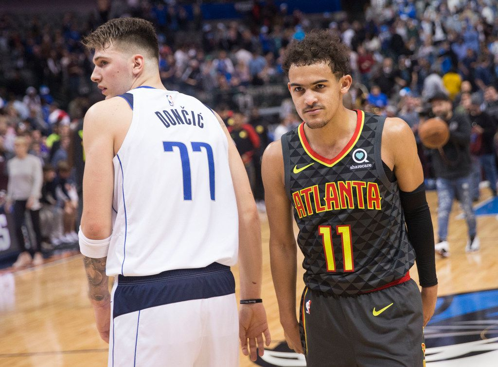 Dallas Mavericks forward Luka Doncic (77) and Atlanta Hawks guard Trae Young (11) after an NBA basketball game at the American Airlines Center in Dallas on Wednesday, December 12, 2018. (Daniel Carde/The Dallas Morning News)