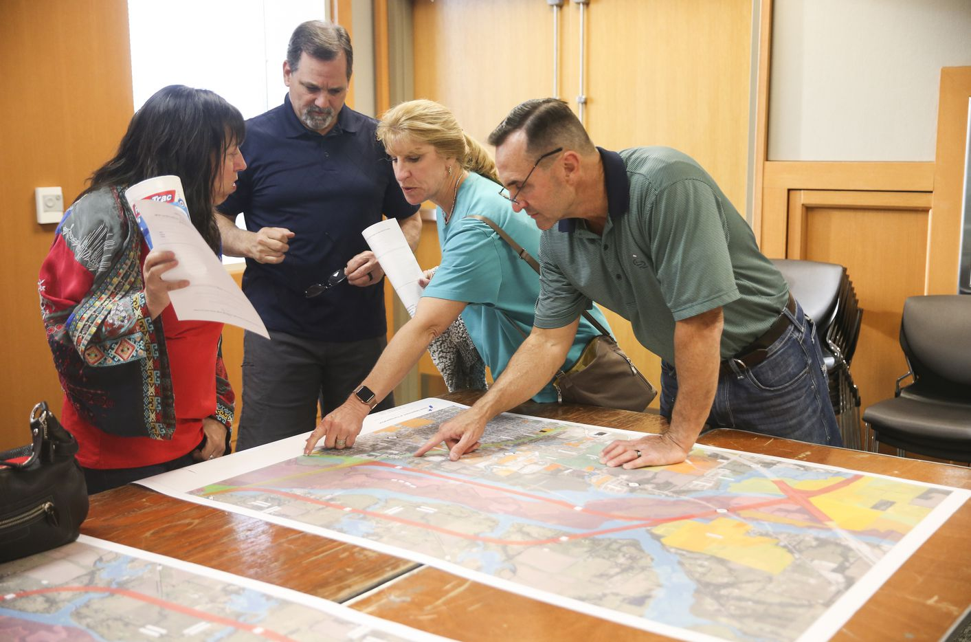 Community members discuss proposed routes for a U.S. 380 bypass during a Texas Department of Transportation open house to display new U.S. 380 alignment maps Thursday, March 21, 2019 at the Russell A. Steindam Courts Building in McKinney.