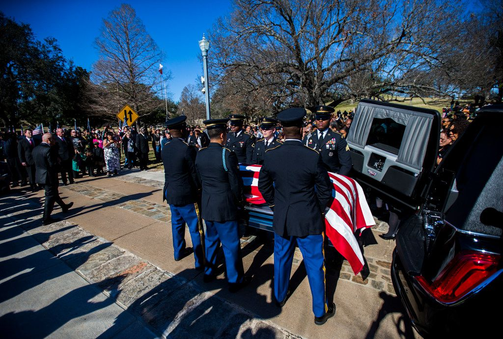 Honor guard members transport the remains of Richard Overton to his burial site during a graveside service on Saturday, January 12, 2019 in Austin. Overton was the oldest living WWII veteran, and oldest living man in the U.S. at 112-years-old until he died on December 27, 2018. He was known for drinking whiskey and smoking cigars on his front porch in east Austin. (Ashley Landis/The Dallas Morning News)