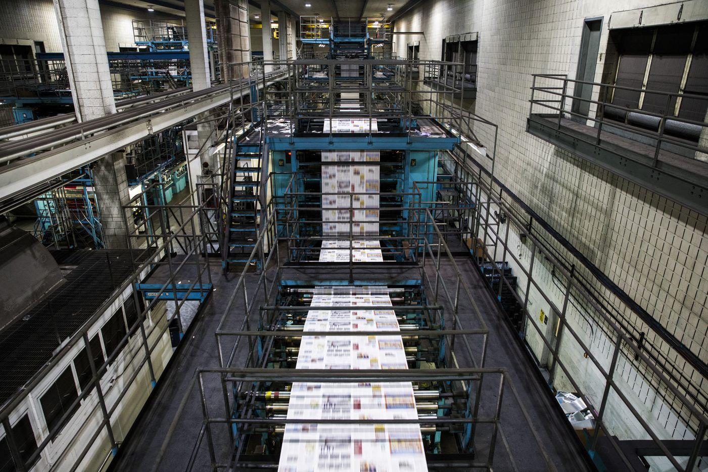 Printing presses roll. (Ashley Landis/The Dallas Morning News)