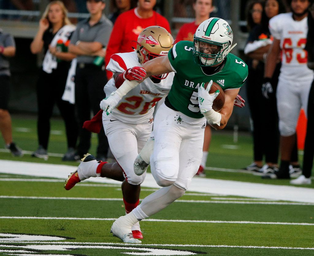 Southlake Carroll's Wills Meyer (5) tries to get away from South Grand Prairie defender Jalon Williams (20) after a reception, during the first half of their high school football game in Southlake Texas on August 30, 2019. (Michael Ainsworth/Special Contributor)
