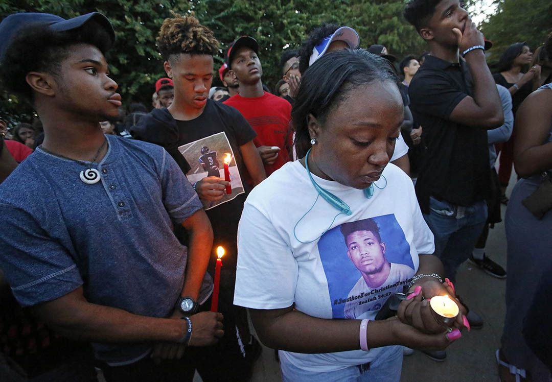 Friends and family gathered at a candlelight vigil for Christian Taylor at Koinonia Christian Church in Arlington on Aug. 8, 2015. (Louis DeLuca/The Dallas Morning News)