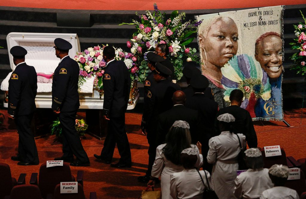 People viewed the open caskets during services for former Dallas  City Council member Carolyn Davis, and her daughter Melissa Nunn Davis on Tuesday at Inspiring Body of Christ Church in Dallas. The mother and daughter were killed in a car crash