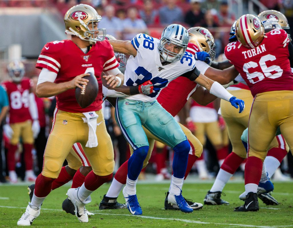 Dallas Cowboys strong safety Jeff Heath (38) looks to sack San Francisco 49ers quarterback Nick Mullens (4) during the first quarter of an NFL preseason game between the Dallas Cowboys and the San Francisco 49ers on Saturday, August 10, 2019 at Levi's Stadium in Santa Clara, California. (Ashley Landis/The Dallas Morning News)