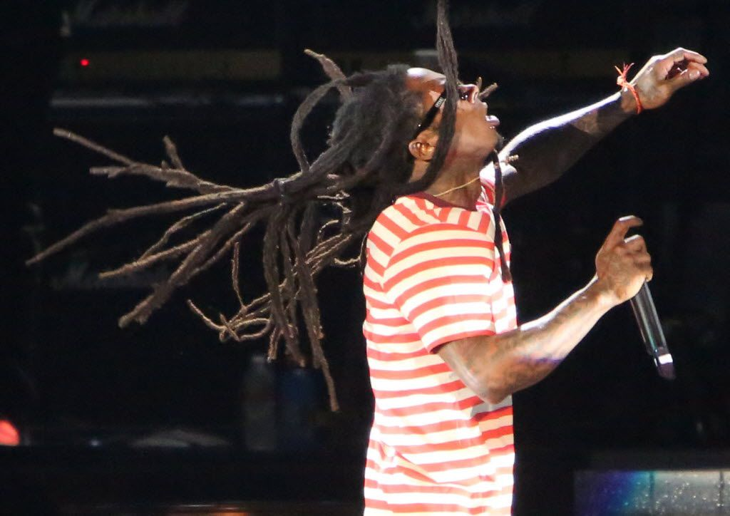 Lil' Wayne's dreads fly in the air during his performance at the World's Most Wanted Music Festival at Gexa Pavillion in Dallas, Texas, Friday, August 16, 2013.
