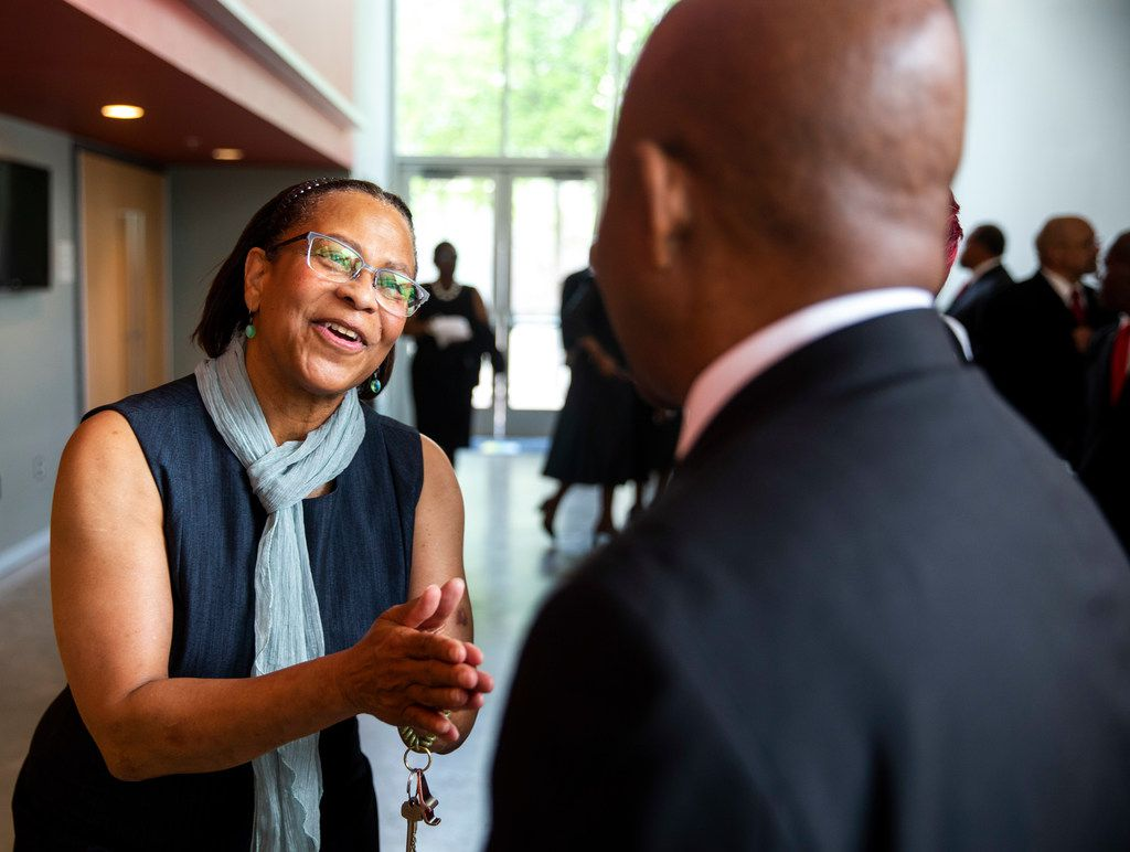Fern Tresvan, director of artistic programs at Booker T. Washington High School chats with Robert L. Jackson Jr., a member of Booker T. Washington High School class of 1969, at Booker T. Washington High School for the Performing and Visual Arts in Dallas on Sunday, June 2, 2019. Fifty years after desegregation separated classmates at Booker T. Washington Technical High School, the class of 1969 turned its reunion Sunday into a belated convocation. Some members of the Class of '69  were unable to graduate from Booker T. Technical High School when a federal desegregation order dispersed them to other Dallas high schools. The ceremony also honored students who would have graduated in 1970 had officials not closed the school.