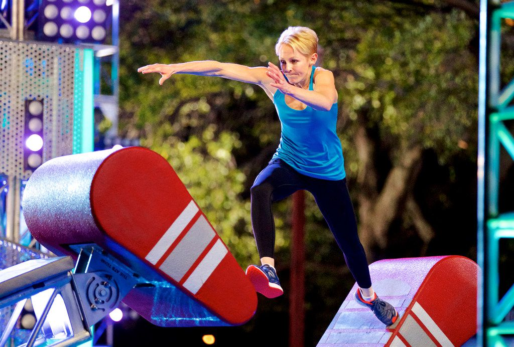 Karen Wiltin of Allen jumps from floating stair to floating stair during a taping of American Ninja Warrior at Fair Park, Sunday, March 25, 2018.