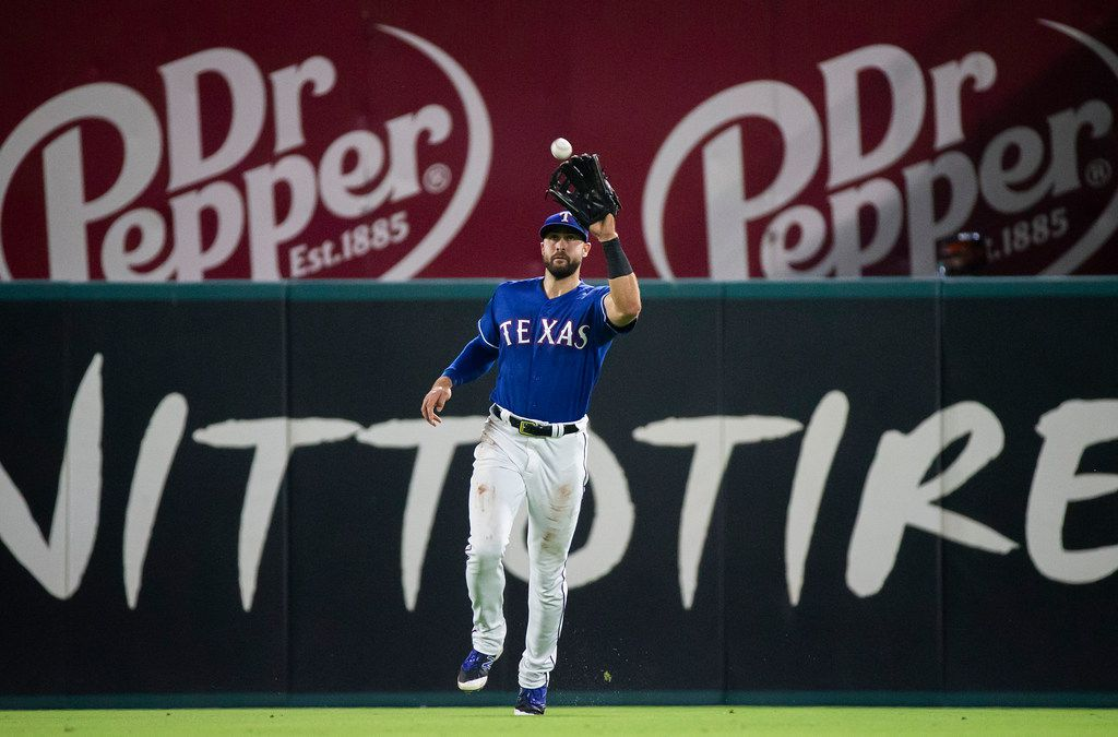 FILE - Texas Rangers center fielder Joey Gallo makes the catch on a line drive by Houston Astros left fielder Tony Kemp during the seventh inning at Globe Life Park on Thursday, June 7, 2018, in Arlington. (Smiley N. Pool/The Dallas Morning News)