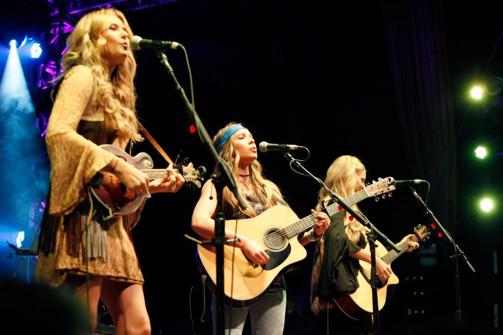 Country music group Runaway June, (Hannah Mulholland, left, Naomi Cooke and Jennifer Wayne, far-right), perform as an opening act for Willie Nelson and Family, at the Granada Theater in Dallas on Jan. 03, 2017.