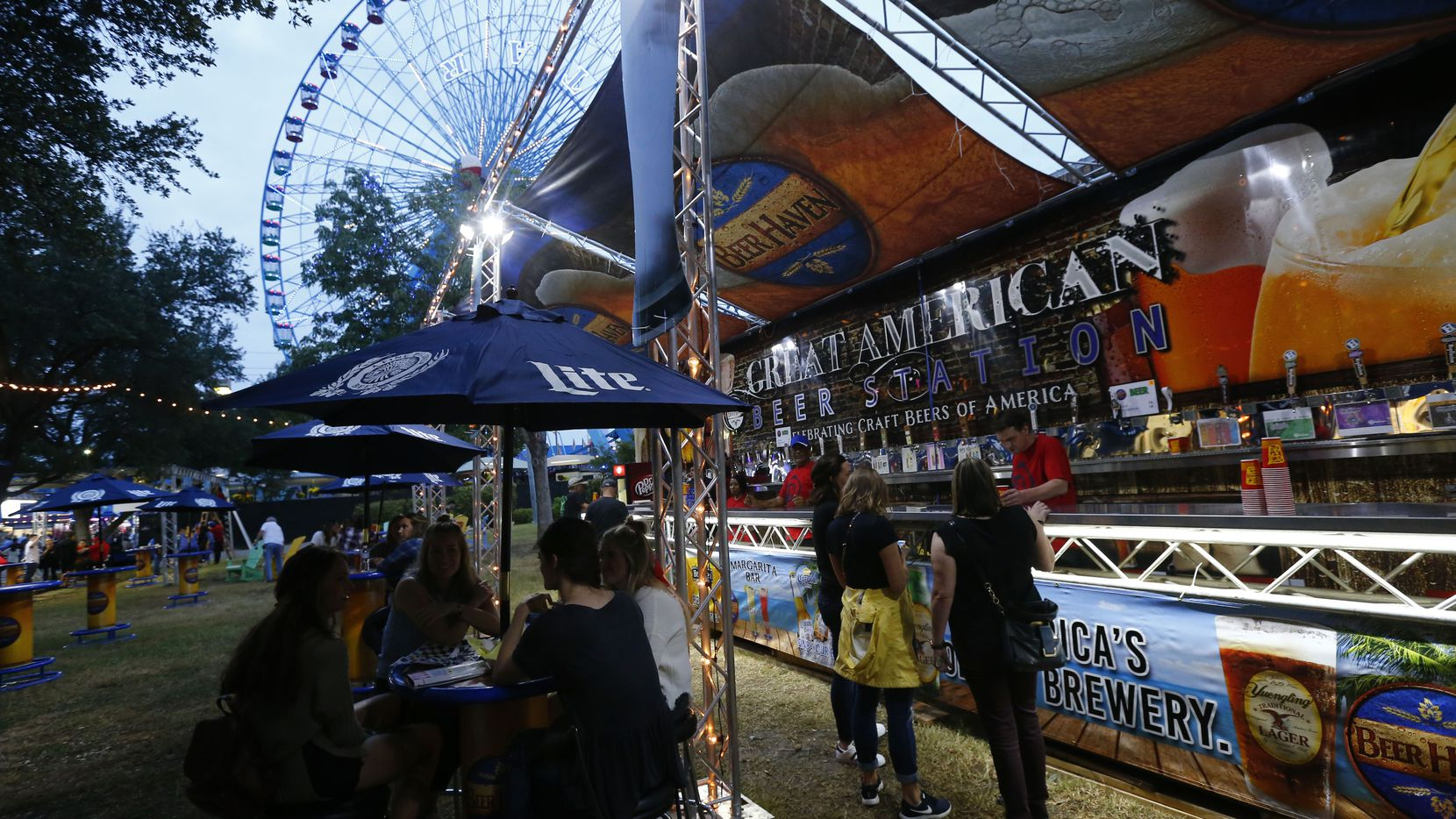 People order beer at the Beer Haven under the Texas Star Ferris wheel during the State Fair of Texas' opening day on Sept. 29, 2017.