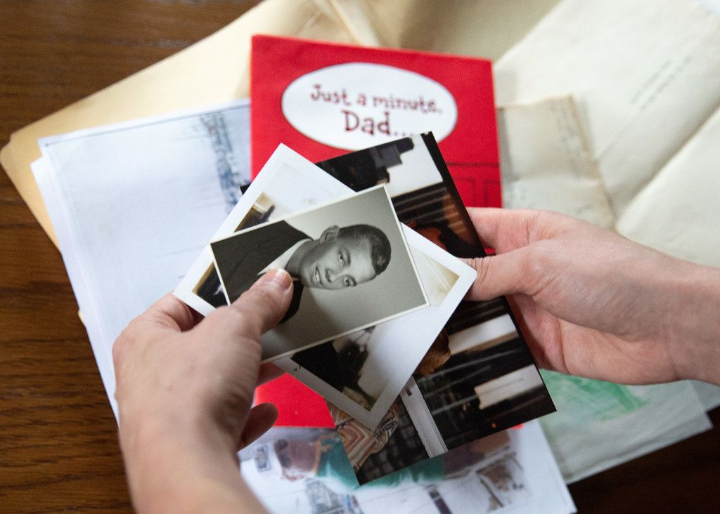 Janielle Kastner looks through old photos and cards belonging to her late father.
