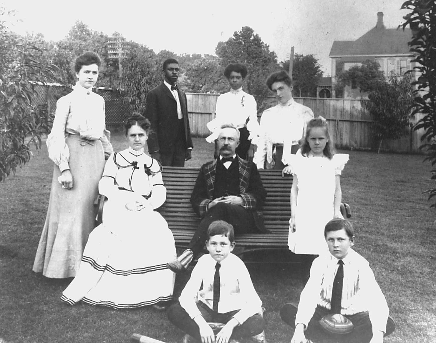 G.B. Dealey and his wife Olivia (seated, left), with their children and two household employees. Clockwise from top are Josh and Viola McCree; and the Dealey children Fannie, Maidie, Walter, Edward (Ted), and Annie. This photo was taken around 1901.