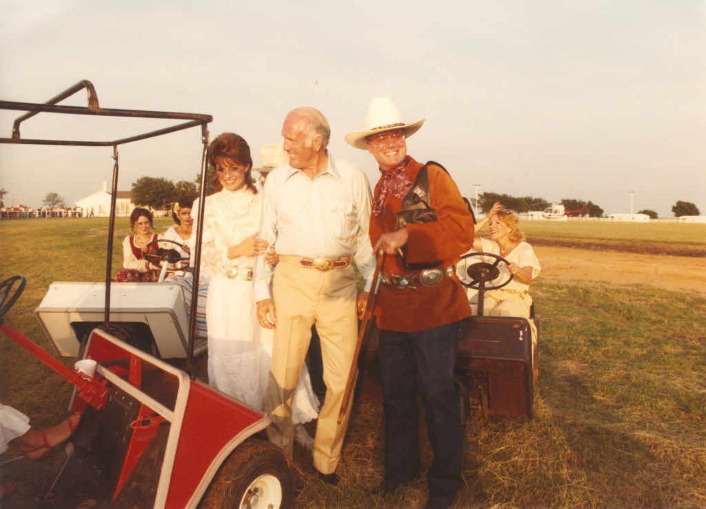 Dallas TV stars Linda Gray and Larry Hagman with businessman Cloyce Box at the 1982 Cattle Baron's Ball at the Box Ranch.