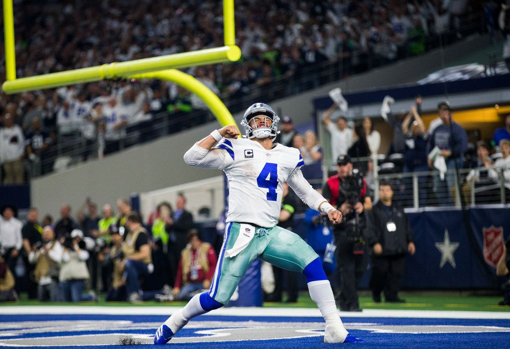 Dallas Cowboys quarterback Dak Prescott (4) celebrates what he thought was a touchdown during the fourth quarter of an NFL playoff game between the Dallas Cowboys and the Seattle Seahawks on Saturday, January 5, 2019 at AT&T Stadium in Arlington, Texas. The Cowboys scored the next play and won 24-22. (Ashley Landis/The Dallas Morning News)