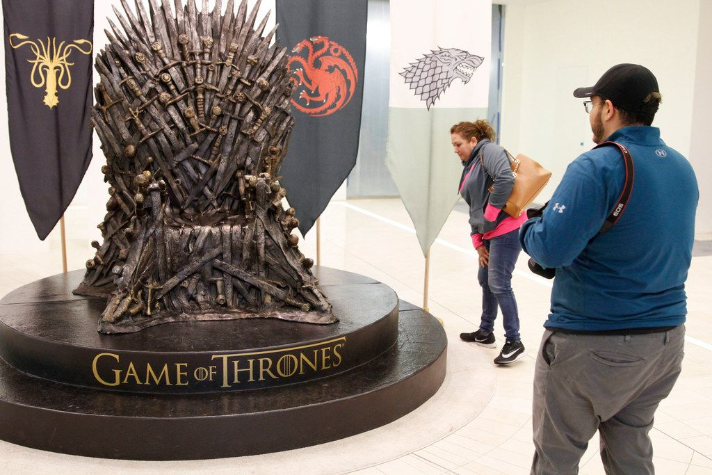 Alejandro Arteaga and his mother, Maria Arteaga, from Garland look at the replica of the Iron Throne from HBO's Game of Thrones in AT&T's headquarters in Dallas. The company also has set up Game of Thrones displays at stores and conferences.