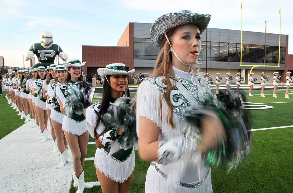 Alexa Wheeler, a captain with the Prosper High School Talonettes, stands at attention before the kickoff as Prosper High School hosted Rowlett High School in a non-district football game at Children's Health Stadium in Prosper on Friday, August 30, 2019. (Stewart F. House/Special Contributor)