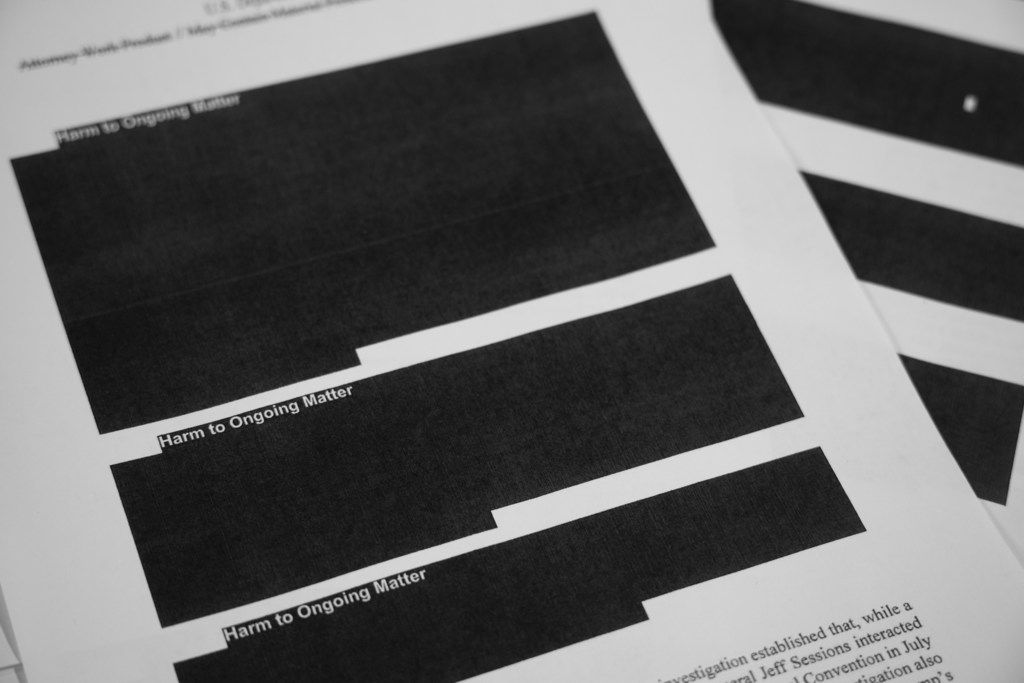 Special counsel Robert Mueller's report, with redactions, as released on Thursday, April 18, 2019, is photographed in Washington. (AP Photo/Jon Elswick)
