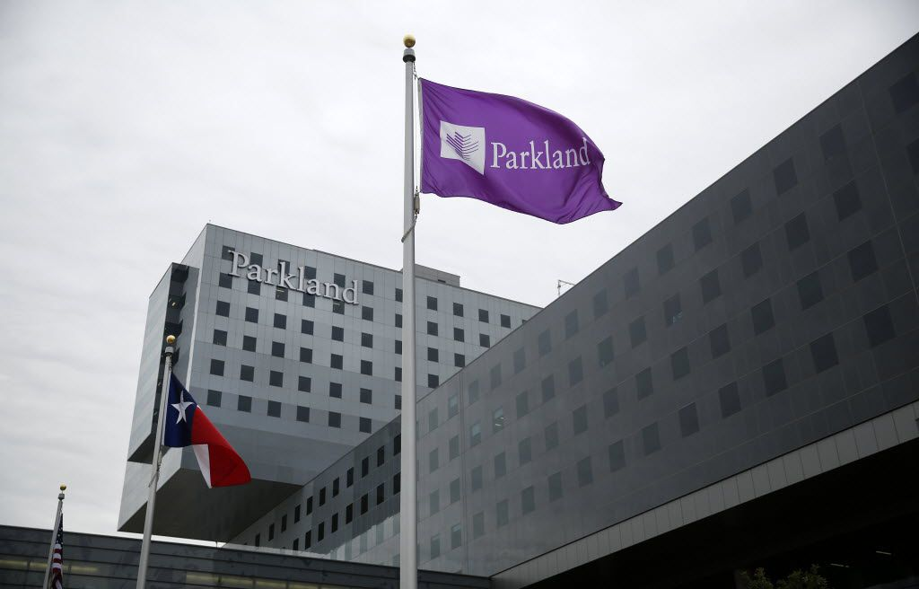 The Texas and Parkland flags fly outside the new 17-story, $1.3 billion Parkland Memorial Hospital, hours after it's opening, Thursday, August 20, 2015. The new hospital will transport public healthcare in Dallas County from a 1950s-era facility to an all-digital, 21st-century landmark. (Tom Fox/The Dallas Morning News)
