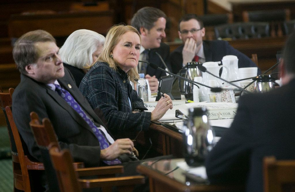 Sen. Sylvia Garcia, D-Houston, listens to people testify on the issue at the Texas Capitol.