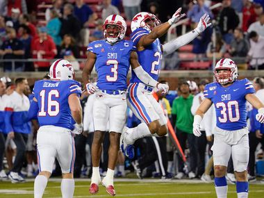 SMU wide receiver James Proche (3) celebrates with safety Rodney Clemons (23) after Proche recovered a Tulane onside kickoff during the second half of an NCAA football game at Ford Stadium on Saturday, Nov. 30, 2019, in Dallas. The Mustangs won the game 37-20. (Smiley N. Pool/The Dallas Morning News via AP)