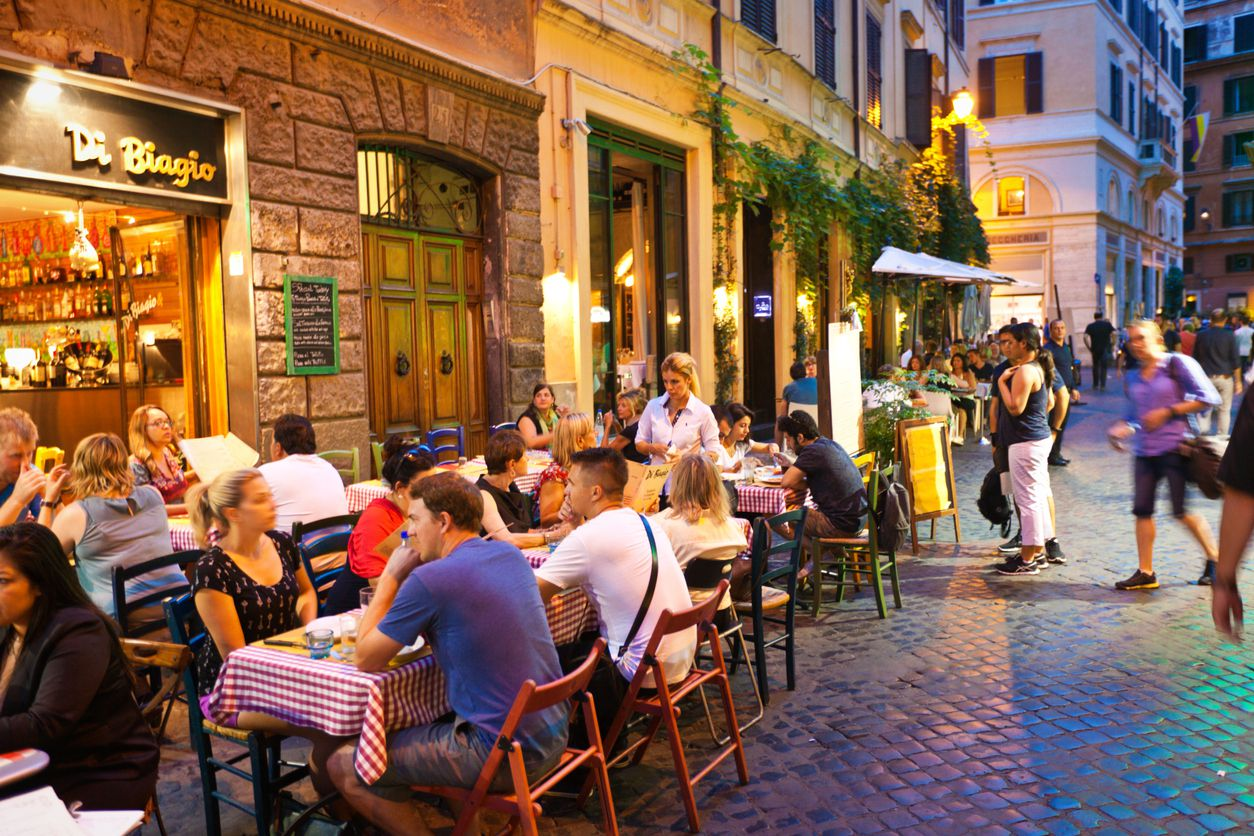 Rome, Italy - Sep 16, 2015: Tourists and local residents enjoying the night life, dining in outdoor street restaurants in the center of Rome in September 2015.