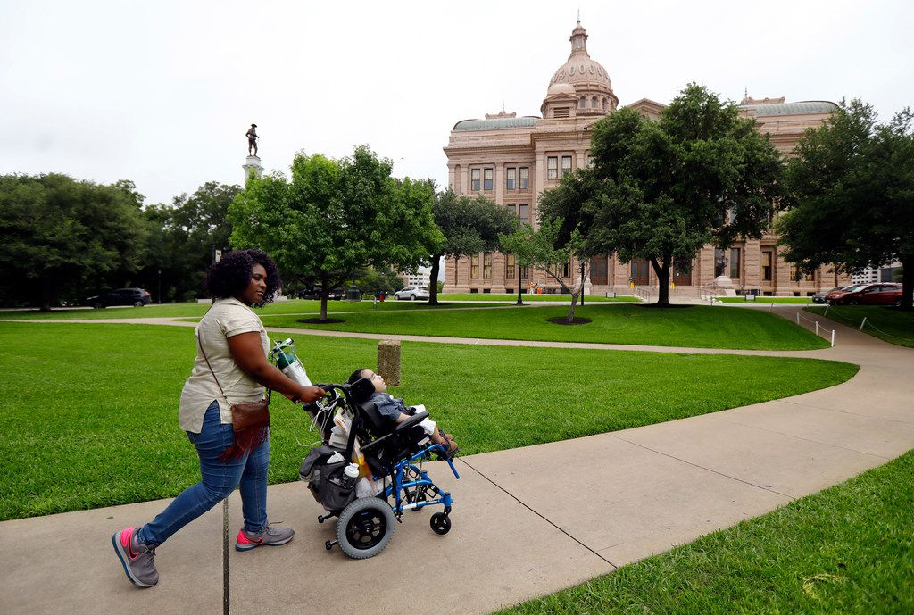 Linda Badawo of Mesquite, Texas pushes her 3 yr-old son D'ashon Morris to the Texas State Capitol for a House Committee on Human Services meeting to discuss recent information reported by The Dallas Morning News regarding Medicaid managed care and the Health and Human Services Commission. Badawo asked to speak and was granted permission to do so before the panel in Austin, Wednesday, June 20, 2018.