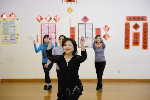 The Dallas Chinese Community Center in Richardson is a stronghold for all things Asian. Tina Chen participates in a line dancing class at the nonprofit center.