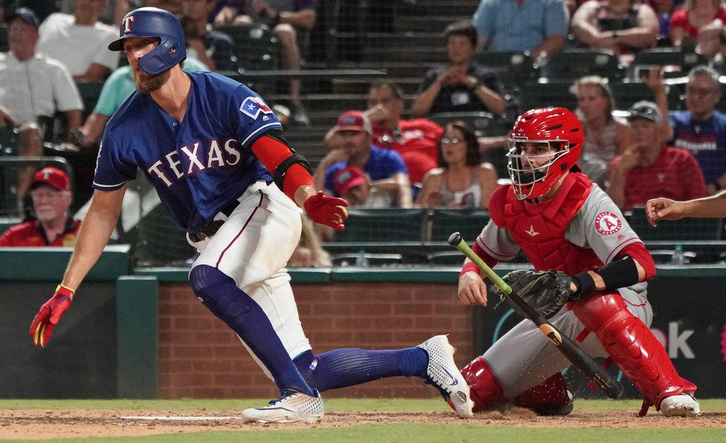 Texas Rangers' Hunter Pence drops his bat after hitting a single to drive in the winning run against the Los Angeles Angels in the ninth inning of a baseball game Wednesday, Aug. 21, 2019, in Arlington, Texas. The Rangers won 8-7. (AP Photo/Louis DeLuca)