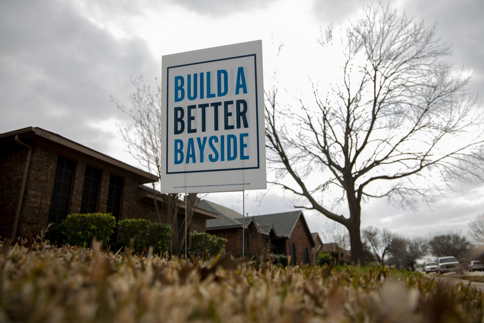 "A ""Build a Better Bayside"" sign is planted in a homeowner's yard in a Rowlett neighborhood."