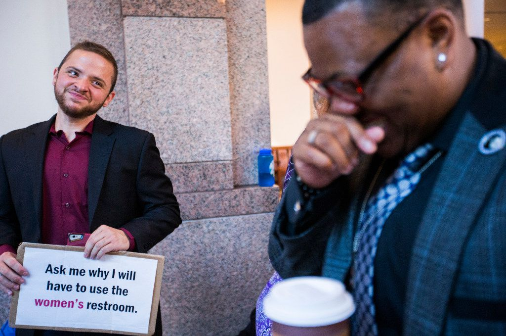 Trenton Johnson (right) jokes with Ethan Avanzino as they stood in line early Friday morning to voice their opposition to the bathroom bill at a Senate State Affairs Committee public hearing at the capitol.